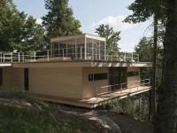 La maison Le Grand Plateau construite en pleine forêt près du Lac Héron dans les Laurentides